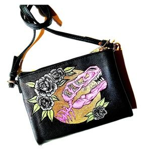 Black crossbody bad with neon t-rex and gold detai